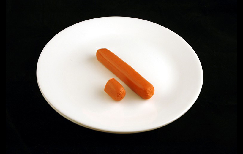 Hot Dogs.   66 grams = 200 Calories.  Courtesy of wiseGEEK.