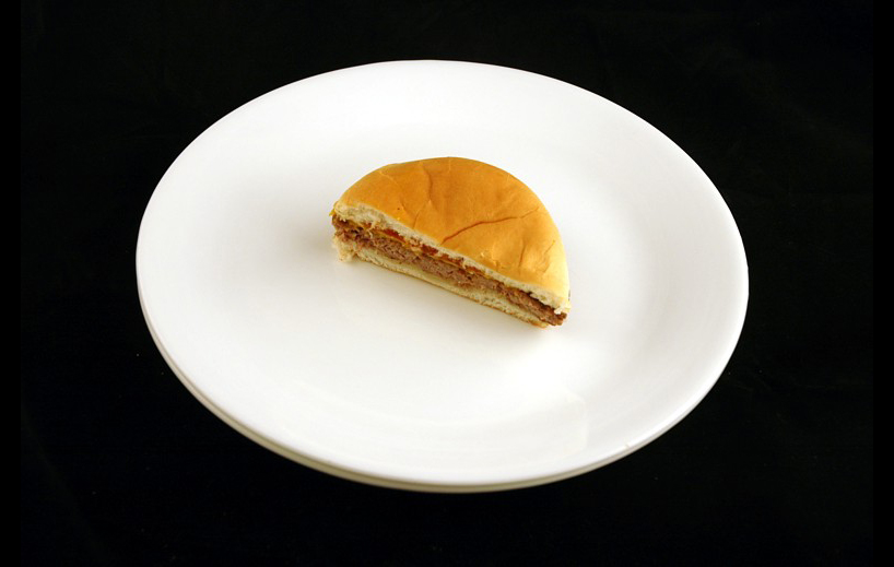 Jack in the Box Cheeseburger.   75 grams = 200 Calories.   Courtesy of wiseGEEK.